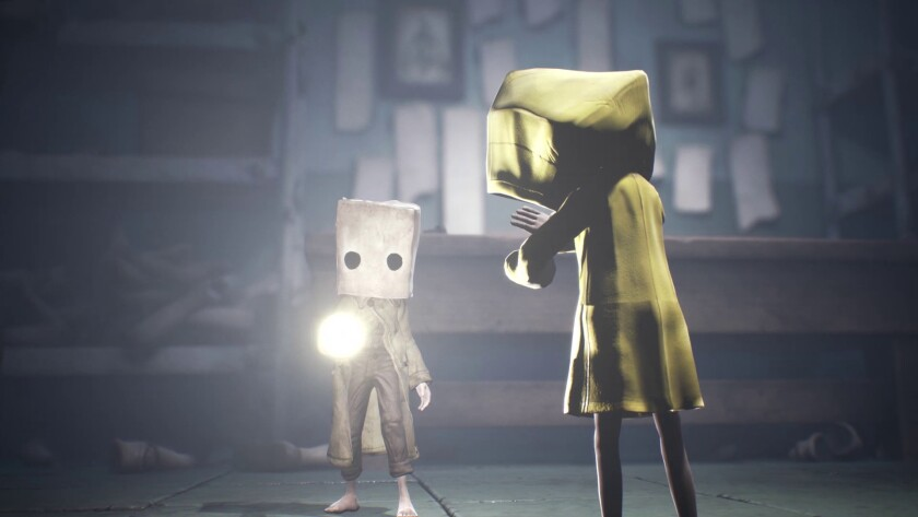 "Two characters in ""Little Nightmares 2."""