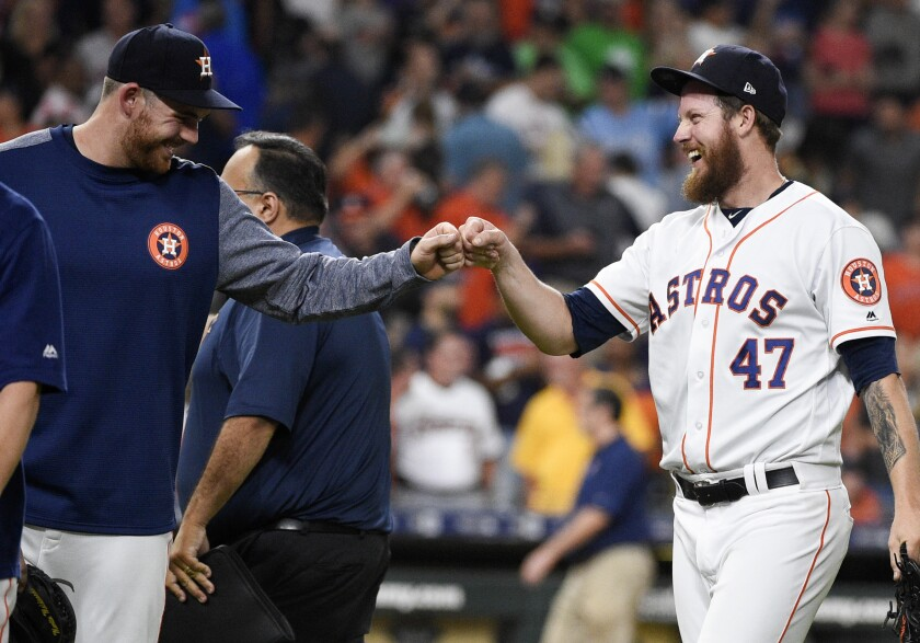 Houston Astros relief pitcher Chris Devenski, right, celebrates with Joe Biagini.