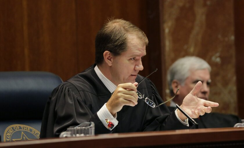In this photo taken Sept. 1, 2015, Texas Supreme Court Justice Don Willett speaks in Austin, Texas. Presumptive Republican presidential nominee Donald Trump has released a list of 11 potential Supreme Court justices he plans to vet to fill the seat of late Justice Antonin Scalia. (AP Photo/Eric Gay)