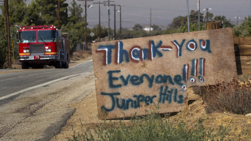 A thank-you sign was posted by Juniper Hills, Calif., residents for firefighters facing the Bobcat fire.