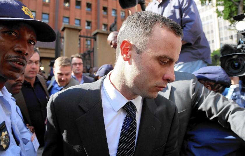 Oscar Pistorius leaves the court in Pretoria, South Africa