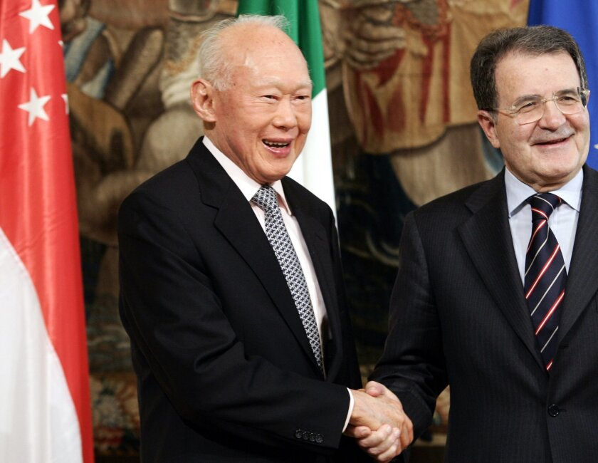 FILE - In this May 17, 2007, file photo,  Singapore's then former Prime Minister Lee Kuan Yew, left, is greeted by Italian Premier Romano Prodi, right, at the Chigi Premier's palace in Rome. Lee brought prosperity to Singapore with an authoritarian system designed to outlast him, but that legacy ma
