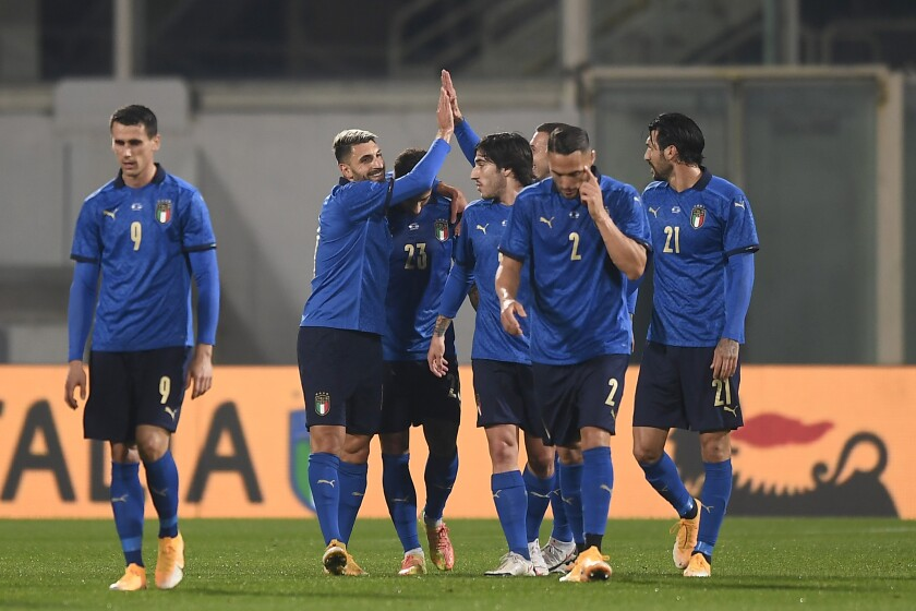 Italy's Vincenzo Grifo, second left, celebrates with teammates after scoring his side's first goal of the game during the international friendly soccer match between Italy and Estonia, at the Artemio Franchi Stadium in Florence, Italy, Wednesday, Nov. 11, 2020. (Fabio Ferrari/LaPresse via AP)