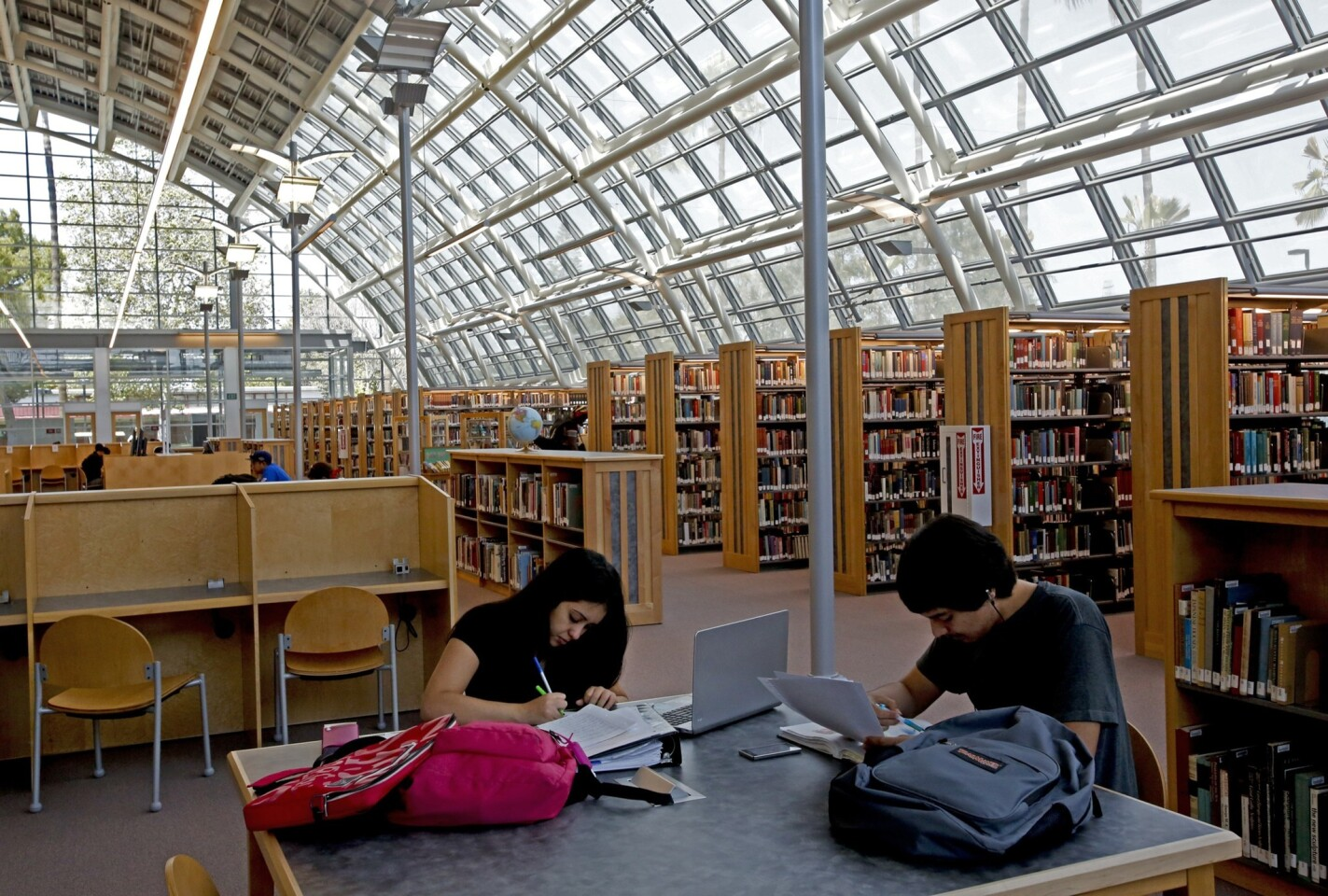 Nursing students Monica Lanco, 20, left, and Fernando Gomez, 22, study in the library before the ribbon-cutting ceremony Tuesday at El Camino College Compton Center. The state-of-the-art library opened last month after a seven-year delay.