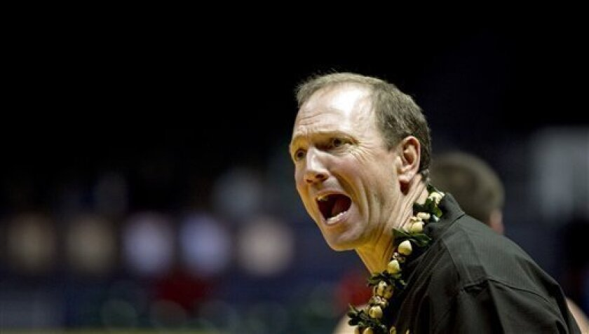 Long Beach State coach Dan Monson reacts to an official's call during the first half of an NCAA college basketball game against Xavier at the Stan Sheriff Center, Thursday, Dec. 22, 2011, in Honolulu. (AP Photo/Marco Garcia)