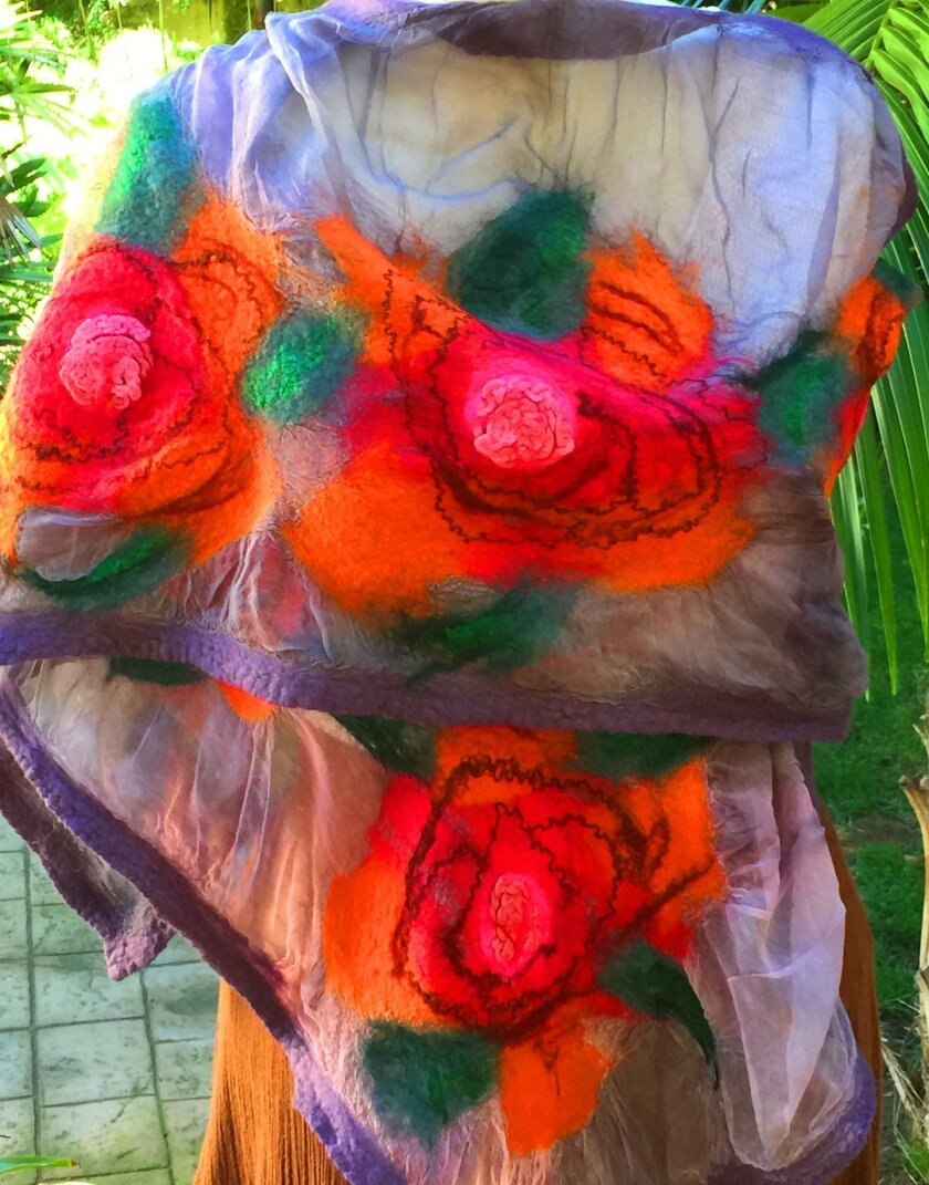 The No Thorns a Nuno shawl by Tami Zohar (Tami Z Creations) can be a great accessory to any garment and makes a beautiful holiday gift; available at Handcrafted in Solana Beach. The handmade shawl is of hand-dyed silk and felted with merino wool upcycled repurposed silk fiber, handspun upcycled sil