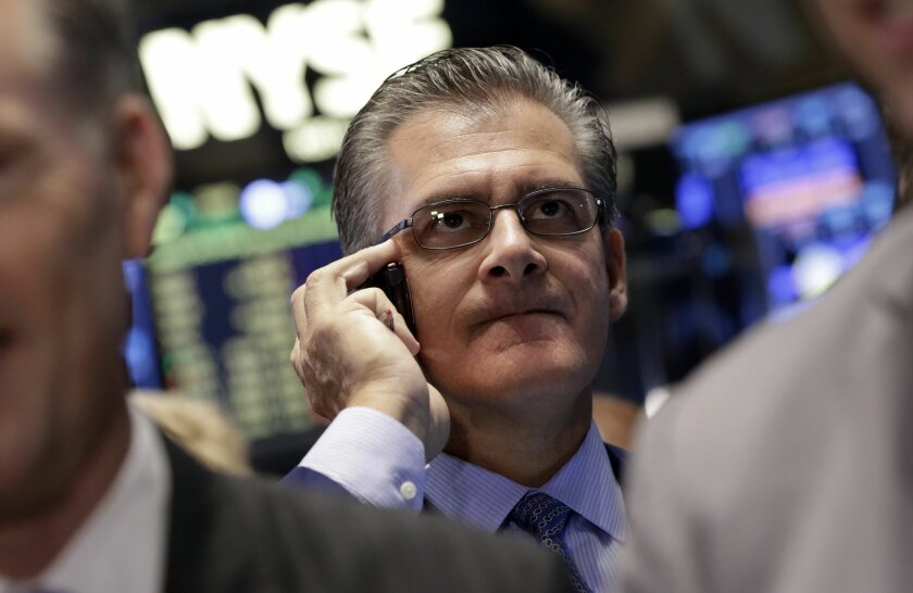 Trader Richard Devicarro works on the floor of the New York Stock Exchange, Friday, Oct. 10, 2014. Major U.S. stock indexes got off to an uneven start in early trading Friday, a day after stocks clocked their worst day of the year. (AP Photo/Richard Drew)