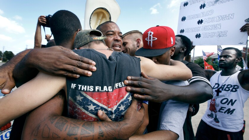 All Lives Matter protesters come together for a group hug with Black Lives Matter activists in Dallas on Sunday.