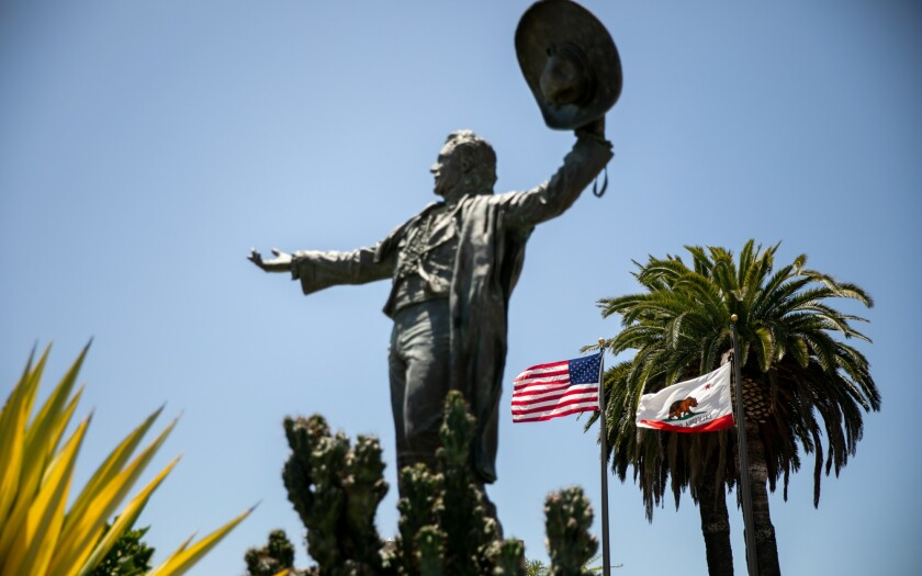 A statue of Don Diego, the late fair ambassador, stands at the gate to the Del Mar Fairgrounds on Wednesday. Fairgrounds officials are asking people to support a request for $20 million in federal aid to help them weather the financial blow they've taken during the pandemic
