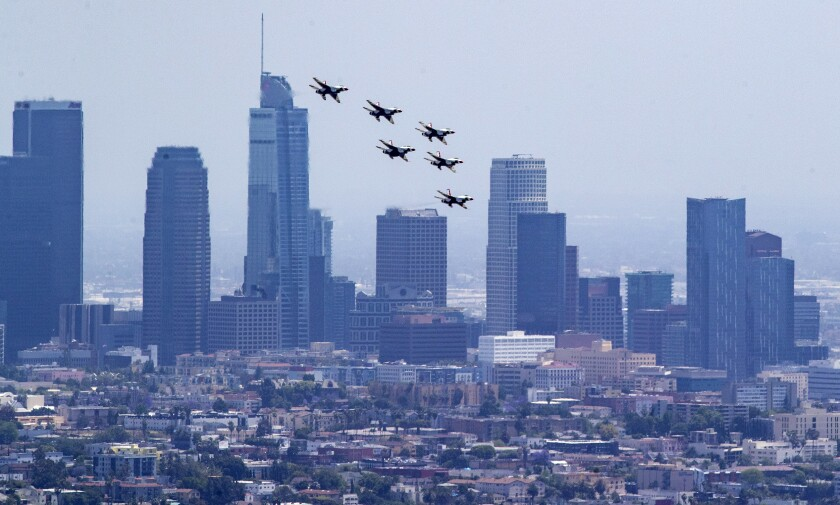 The Air Force Thunderbirds fly in formation over downtown Los Angeles Friday afternoon.