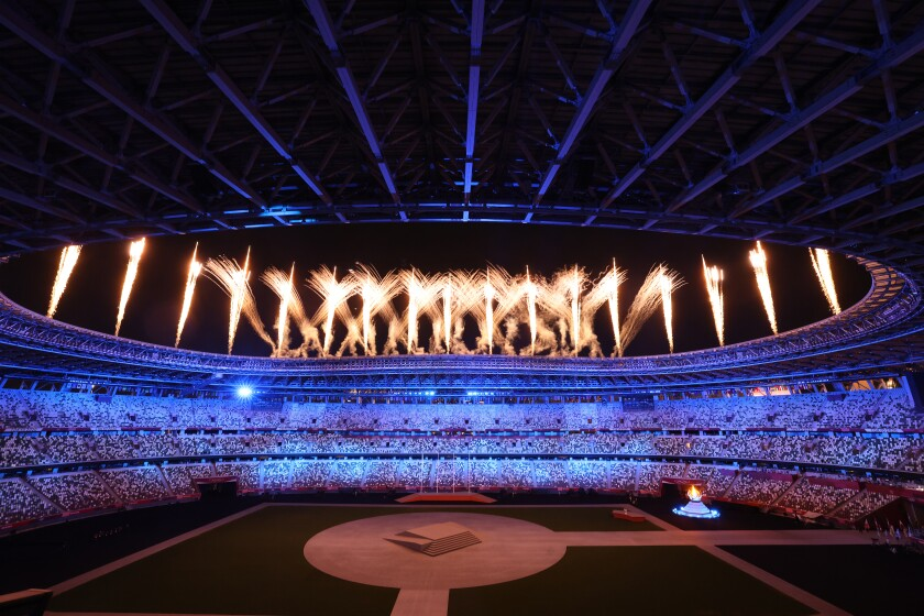 Fireworks goes off over Olympic Stadium during the closing ceremony for the Tokyo Olympic Games.