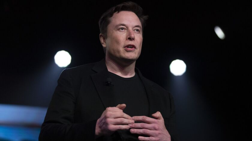 Tesla Chief Executive Elon Musk speaks at the company's design studio in Hawthorne on March 14.