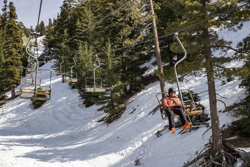 Mt. Baldy is opening today, but with restrictions, including a COVID-19 social distancing plan. Above: A skier rides a lift on Jan. 18, 2020.