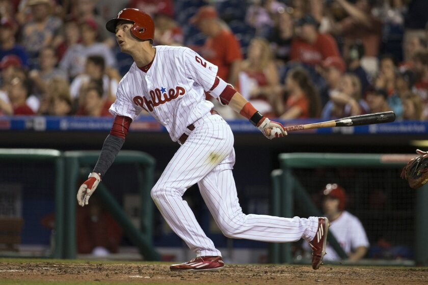 Philadelphia Phillies' Tyler Goeddel watches his two-run home run during the seventh inning of a baseball game against the Washington Nationals, Wednesday, June 1, 2016, in Philadelphia. The Nationals won 7-2. (AP Photo/Chris Szagola)