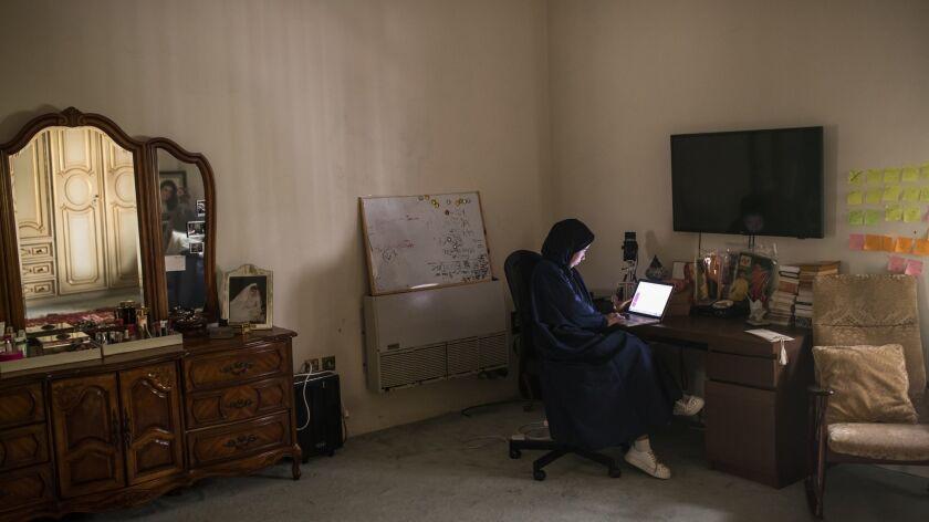 Jowaher Alamri working in her room/studio