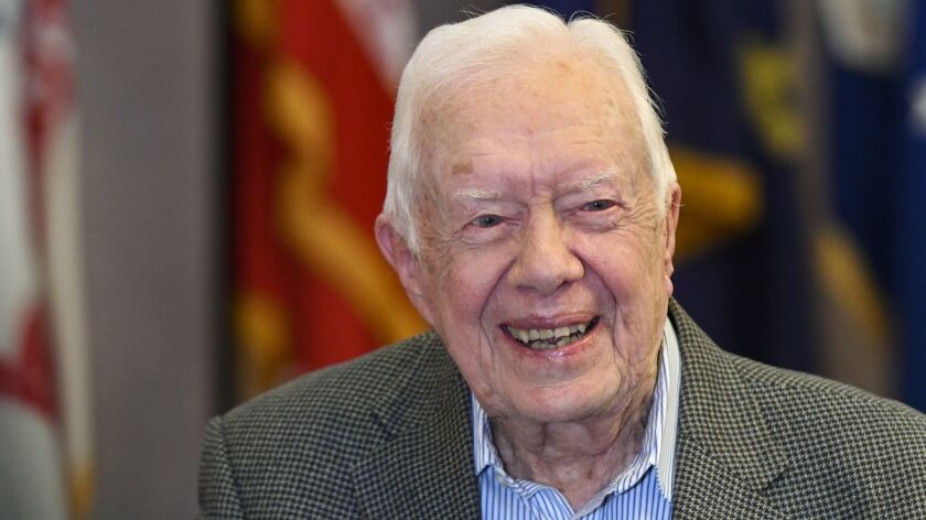 FILE - In this Wednesday, April 11, 2018 file photo, former President Jimmy Carter, 93, sits for an