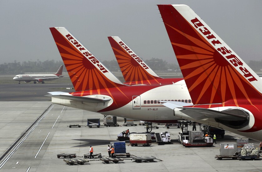 """FILE - In this April 29, 2011 file photo, passenger jets from Air India, India's national carrier, stand at Indira Gandhi International Airport in New Delhi, India. India's government says it has received """"multiple expressions of interest"""" in buying its 100% stake in the debt-laden national carrier Air India to shore up falling government revenues after an initial attempt in 2018 failed to attract any bidders. The deadline for submission of formal bids was Monday, Dec. 14, 2020, and the government is expected to announce the qualified bidders on Jan. 5. It did not reveal the identity of the bidders or the number of bids received. (AP Photo/Kevin Frayer, File)"""