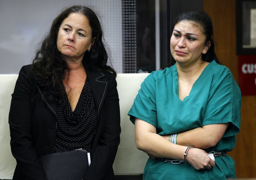 Crystal Cardenas, right, with attorney Megan Marcotte, was sentenced Tuesday in San Diego Superior Court to 15 years to life for killing her 9-year-old daughter, Elizabeth Holloway.