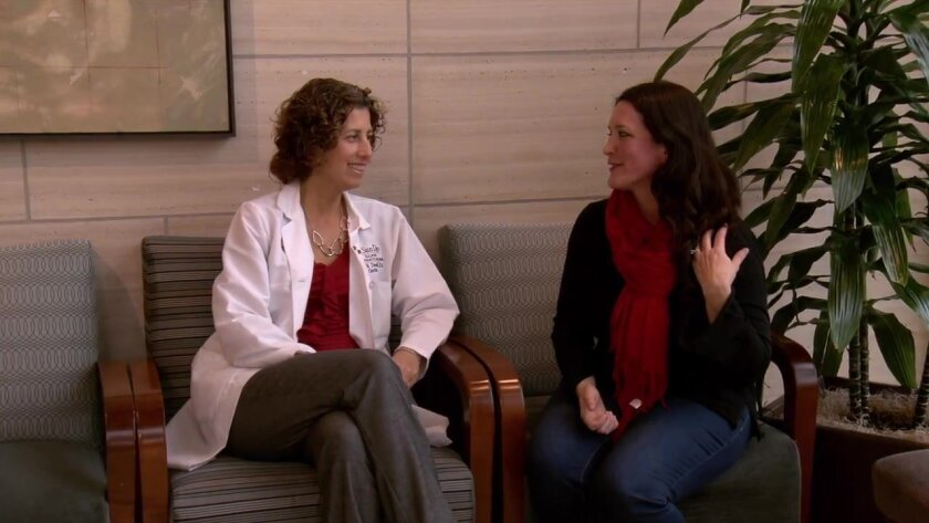 UCSD cardiologist Lori Daniels, left, talks with Beth Garcia about her heart attack.
