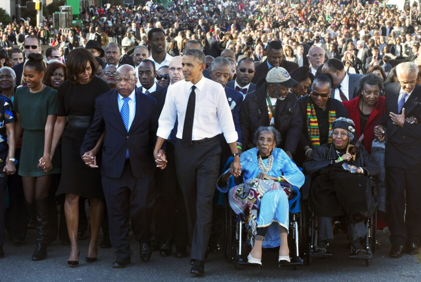 "President Obama holds hands with Rep. John Lewis and Amelia Boynton Robinson, who were both beaten during ""Bloody Sunday"" in 1965. Obama gave a speech in Selma over the weekend discussing civil rights in America."