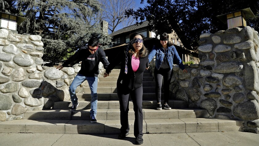 "Martha Munguia, center, and her children Rudy Munguia, 23, left, and Alina Munguia, 24, do their best movie recreation at the ""Bird Box"" house in Monrovia."