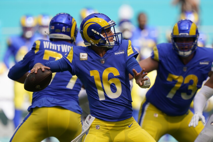 Los Angeles Rams quarterback Jared Goff (16) looks to pass during the first half of an NFL football game.