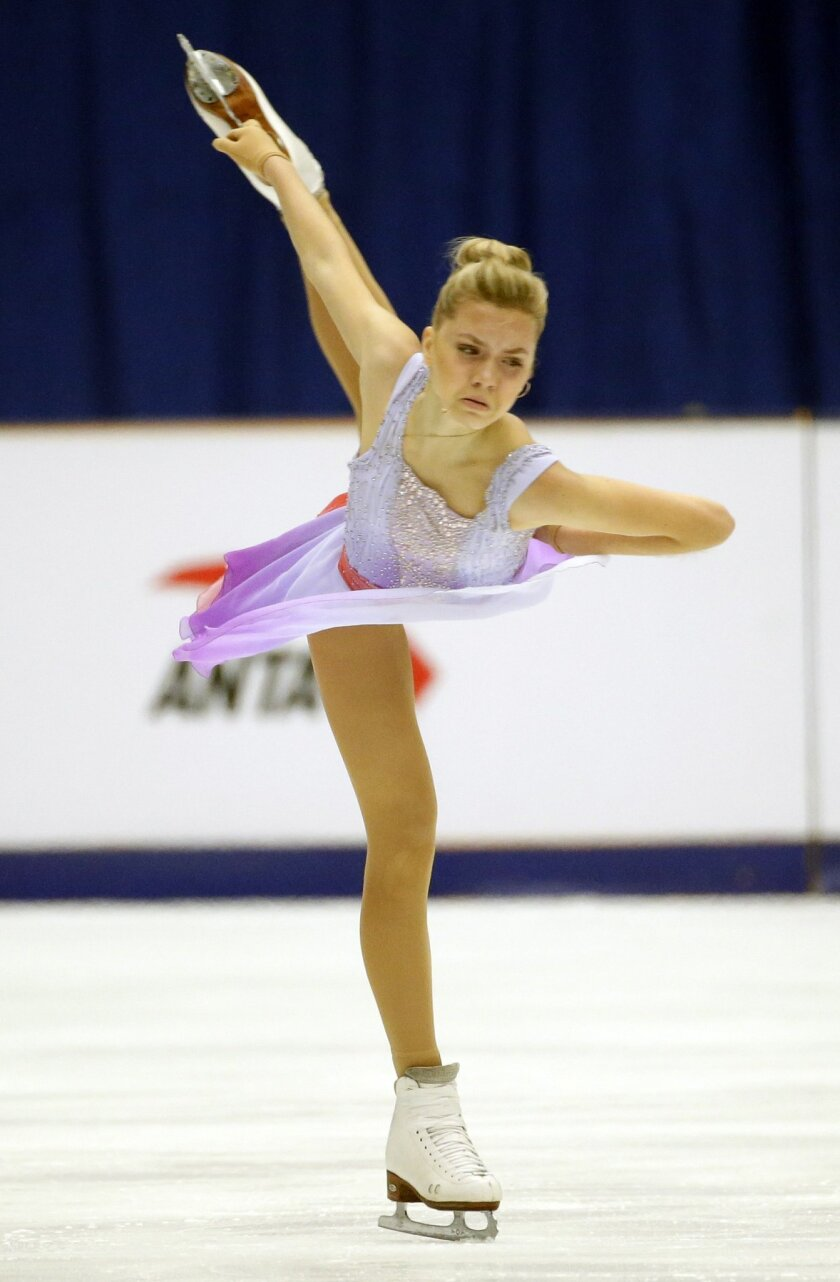 Russia's Elena Radionova competes in the Ladies Free Skating program during the ISU Grand Prix of Figure Skating at the Capital Gymnasium in Beijing, China, Saturday, Nov. 7, 2015. (AP Photo/Mark Schiefelbein)
