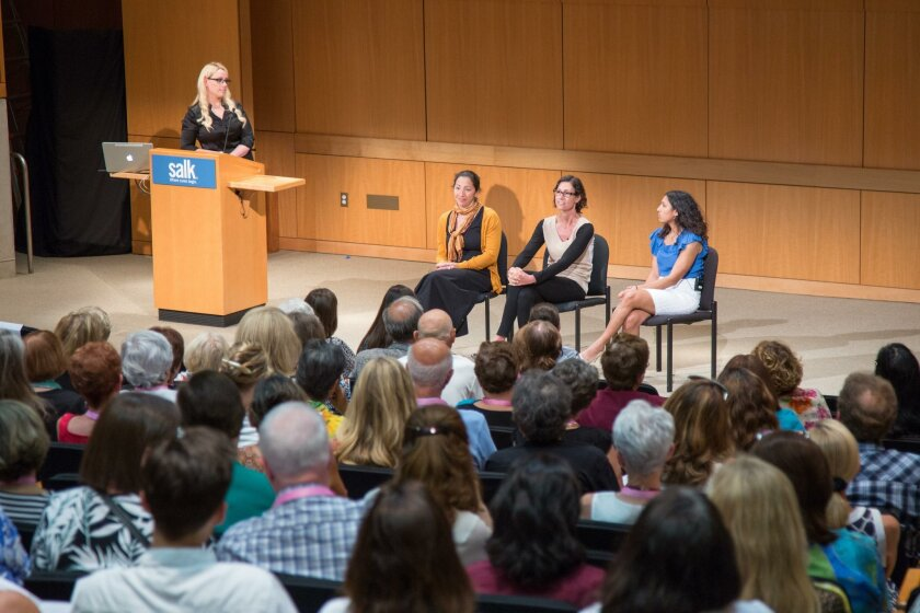 Salk Assistant Professor Janelle Ayres (at podium) fields questions from the audience for research associates Amandine Chaix, Maryam Ahmadian and Sheila Rao.