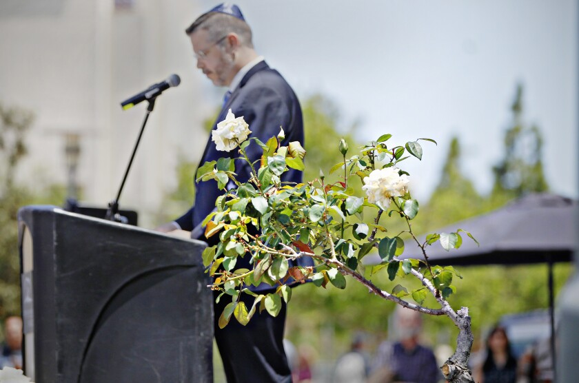 SAN DIEGO, CA May 1st, 2019 | CSUSM chief diversity officer Dr. Joe-Joe McManus speaks during the Rededication of the White Rose Memorial (right, foreground) ceremony on Wednesday at CSUSM in San Marcos, California. | (Eduardo Contreras / San Diego Union-Tribune)
