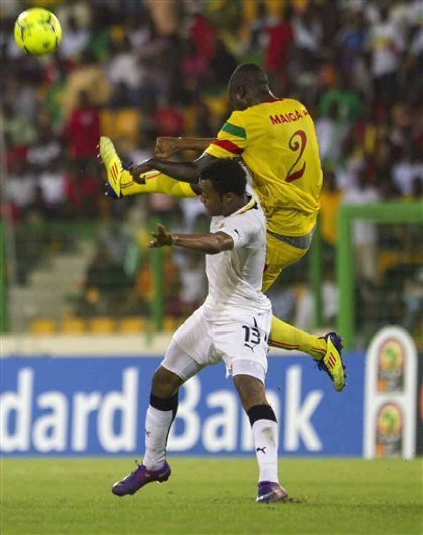 Mali's Abdoulaye Youssouf Maiga, right,fights for the ball with Ghana's Daniel Tawiah Opare during the African Cup of Nations third place soccer match against Ghana in Malabo Stadium in Malabo, Equatorial Guinea, Saturday, Feb. 11, 2012. (AP Photo/Ariel Schalit)