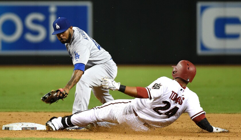 Dodgers' Howie Kendrick, left, tags out Diamondbacks' Yasmany Tomas at second base during the ninth inning on Tuesday.