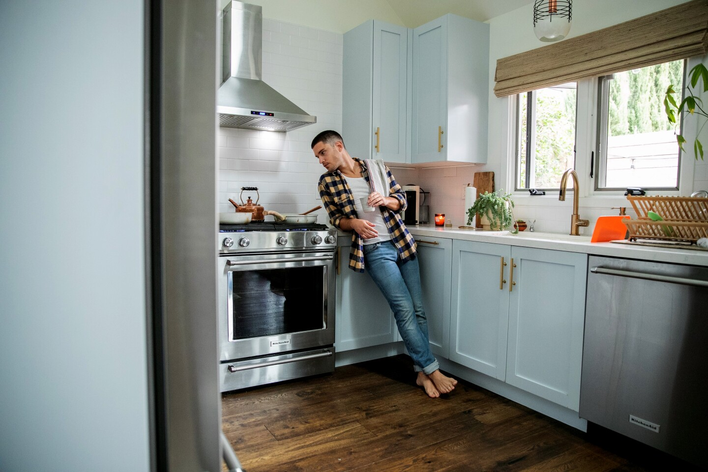 Actor Ronen Rubinstein finds that cooking in his light-filled kitchen helps him keep a positive attitude as he isolates at home. Photographed April 5, 2020. (Stephen LaMarche)