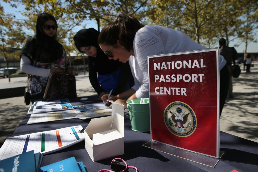 Newly naturalized Amerian citizens had an opportunity last Thursday to apply for U.S. passports at Liberty State Park in Jersey City, N.J. You can do the same when the L.A. Passport Office opens Saturday for walk-in applicants.
