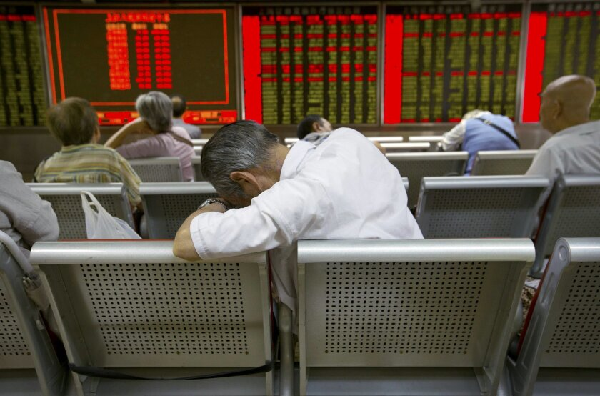 FILE - In this Tuesday, Aug. 25, 2015, file photo, Chinese investors monitor stock prices at a brokerage house in Beijing. Volatility in Chinese stocks roiled global markets this week, showing how big and closely-watched China's market has become - and reminding investors that stock markets can and do swing wildly. (AP Photo/Mark Schiefelbein, File)