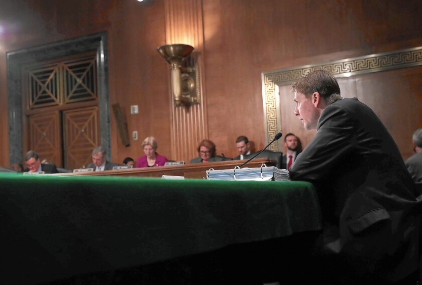 """Richard Cordray, director of the Consumer Financial Protection Bureau, testifies at a Senate hearing last month. Class-action bans deny """"consumers the right to seek justice and relief for wrongdoing,"""" he says."""