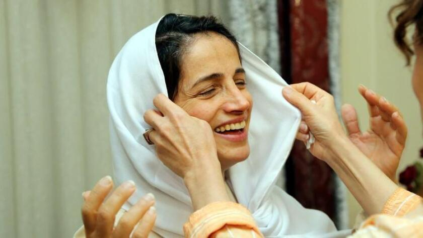 A relative of former imprisoned Iranian lawyer and human rights activist Nasrin Sotoudeh adjusts her scarf at her house in Tehran.