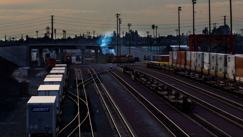 Smoke billows from a locomotive at a San Bernardino rail yard. Southern California air quality regulators delayed action on a pollution-reduction plan that relies on voluntary measures for ports, rail yards and other freight-handling facilities.