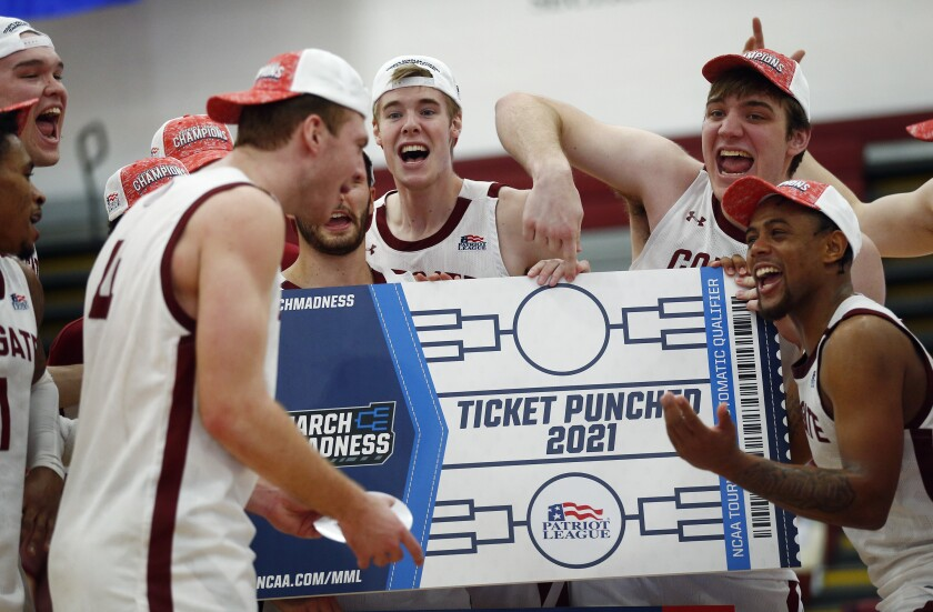 Colgate players celebrate beating Loyola (Md.), in an NCAA college basketball game in the finals of the Patriot League tournament, Sunday, March 14, 2021, in Hamilton, N.Y. (AP Photo/John Munson)
