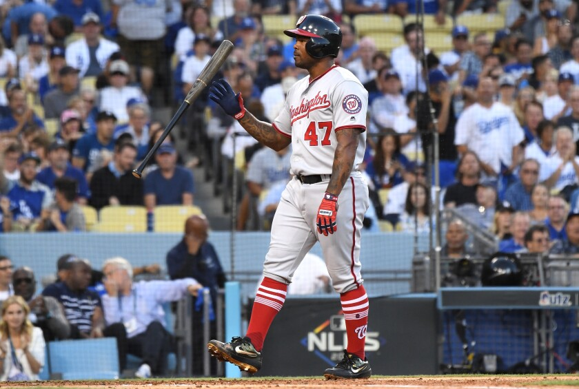Washington Nationals first baseman Howie Kendrick tosses his bat after striking out.