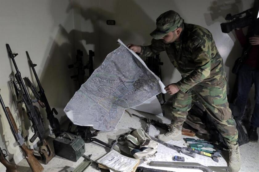 Syrian solider explains a map the army seized at Zamalka town, Eastern Ghouta, in the countryside of Damascus, Syria, 08 April 2018. EFE/EPA
