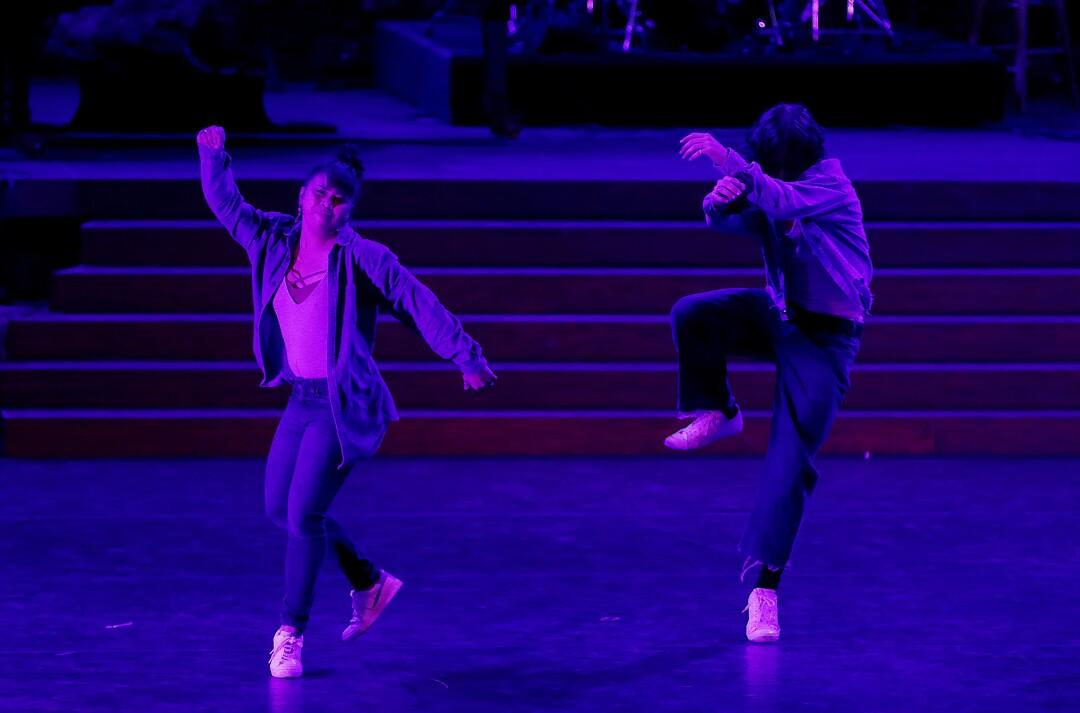 Jasmine Rafael, left, dances with her team.