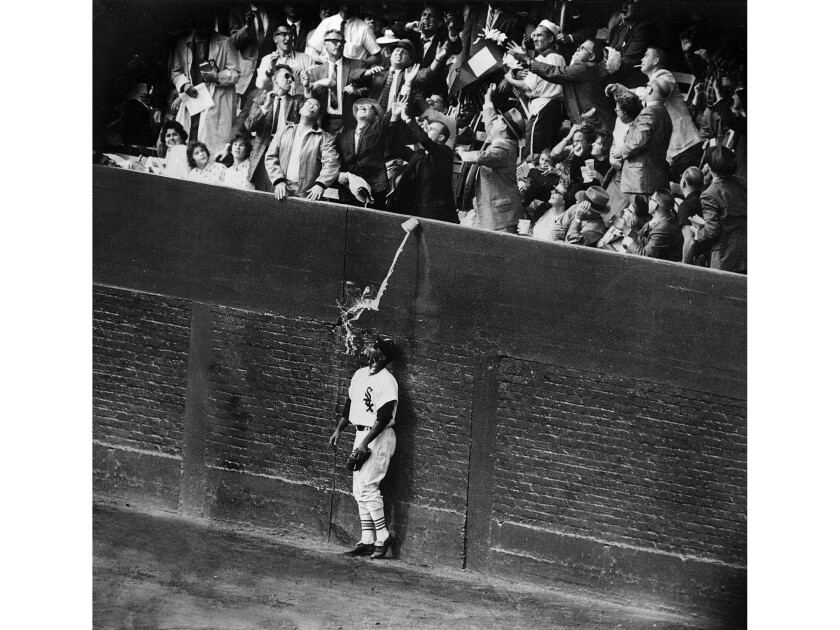 Oct. 2, 1959: Chicago White Sox outfielder Al Smith is drenched by a cup of beer as fans try to catch Los Angeles Dodgers' Charlie Neal's fifth inning home run during the World Series game in Chicago. Neal's home run tied the game 2-2. The Dodgers won 4-3.