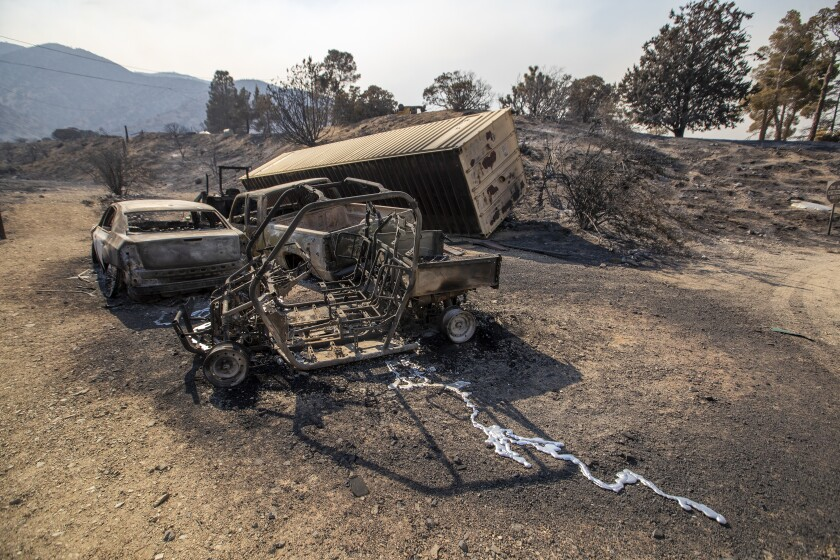 The remains of burned automobiles from the Bobcat fire in the Angeles National Forest