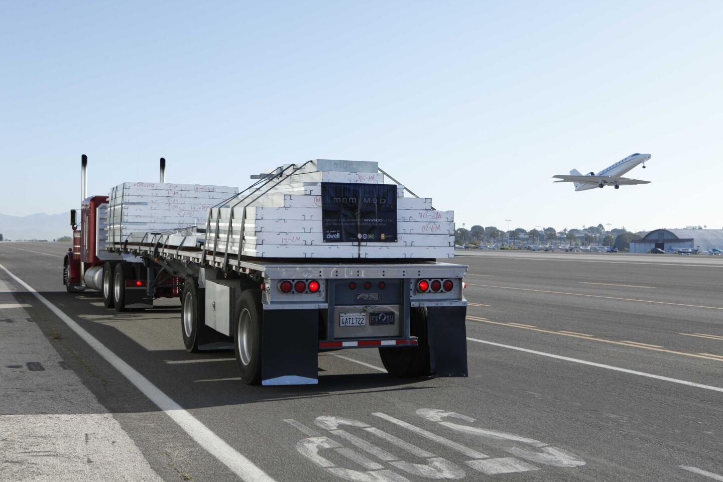 The mnmMOD panels are produced in Vernon and then transported by flatbed truck to the building site.