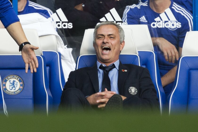 Chelsea's head coach Jose Mourinho reacts to a refereeing decision during the English Premier League soccer match between Chelsea and Liverpool at Stamford Bridge stadium in London, Saturday, Oct. 31, 2015.  (AP Photo/Matt Dunham)