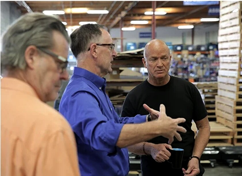 Flux Power CEO Ron Dutt, center, talks at the company located in Vista.