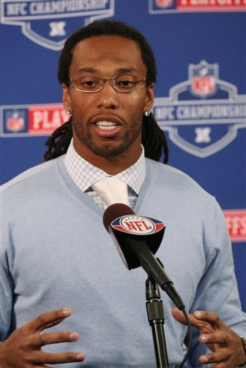 Arizona Cardinals' Larry Fitzgerald answers questions during a news conference at the team's football training facility on Friday, Jan. 16, 2009, in Tempe, Ariz.  The Cardinals face the Philadelphia Eagles in the NFC Championship football game Sunday in Glendale, Ariz. (AP Photo/Ross D. Franklin)