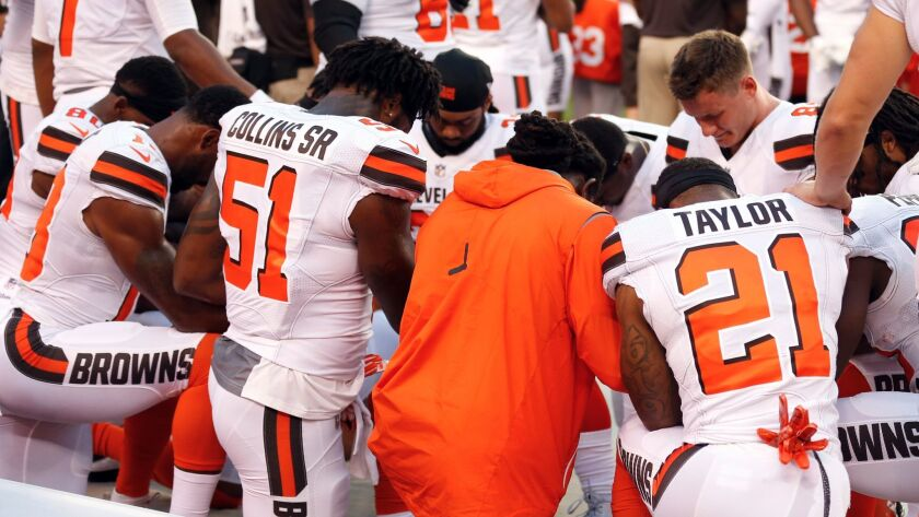 Members of the Cleveland Browns kneel during the national anthem before an NFL preseason football ga