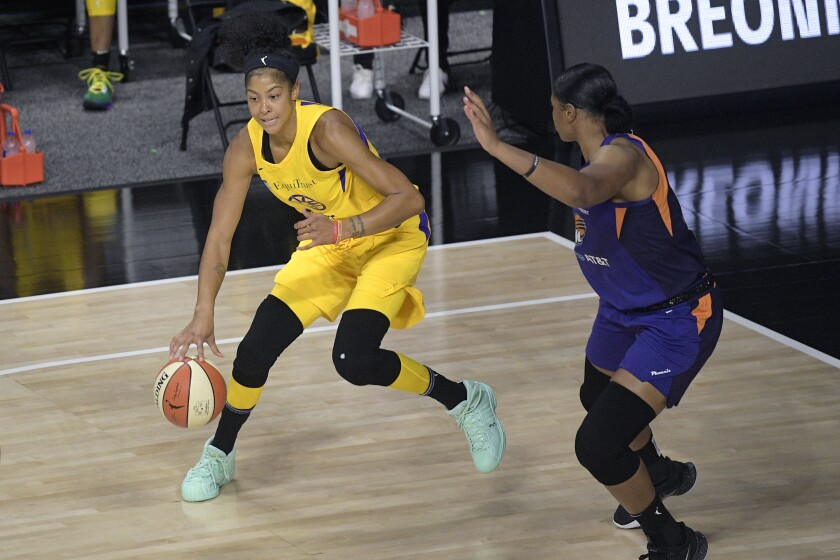 Candace Parker, left, drives against Phoenix Mercury center Kia Vaughn during the first half Saturday.
