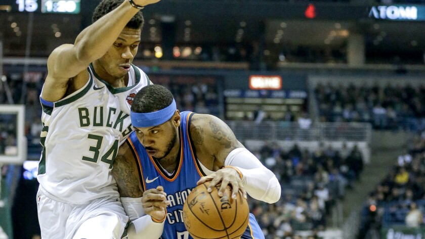 Thunder forward Carmelo Anthony drives against Bucks forward Giannis Antetokounmpo during the first half Tuesday.